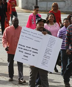 MICHAEL MURRAY/ATR: One participant in the march carried a sign displaying quotes from Dr. Martin Luther King's powerful speeches.