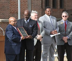 MICHAEL MURRAY/ATR: At left, Rev. Mathis Wright, president of the Sumter County unit of the NAACP, receives the R.L. Freeman Award for servece to the community. The award was presented by REv. Eugene Hall, of Jackson Grove Baptist Church, DeSoto. Others shown at the annual Martin Luther King, Jr. birthday celebration are , from left, State Senator, Greg Kirk (R) Americus, Sumter County Commissioner, Clay Jones, and Sumter County Board of Commissioners chairman, Randy Howard.