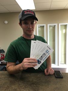 Jesse Harbuck is shown with the tickets he won.