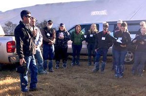 Adam Graft of Leatherbrook Holsteins, at left, speaks to dairy science students from across the southeast.