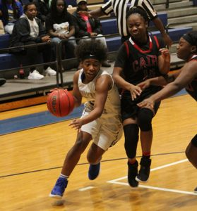 MICHAEL MURRAY I ATR:   ASHS' Shidajah Johnson blasts past a Cairo guard during the Lady Panthers' Feb. 7 region tournament match-up in Americus.