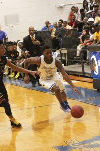 MICHAEL MURRAY I ATR:   ASHS' Stephon Luster drives down the court during the second half of the Panthers' state tournament match-up against the Thomson Bulldogs on Feb. 18 in Americus.