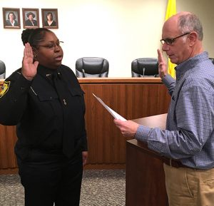 SUBMITTED PHOTO Carolina Pittman has been promoted to the rank of sergeant. Americus Mayor Barry Blount is shown swearing her in.