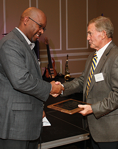 GSW Alumni Association President Lemond Hall presents the Aeolian Award to Sparky Reeves.