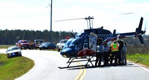One of the accident victims was ejected from the vehicle, and was airlifted to a Macon hospital Friday.
